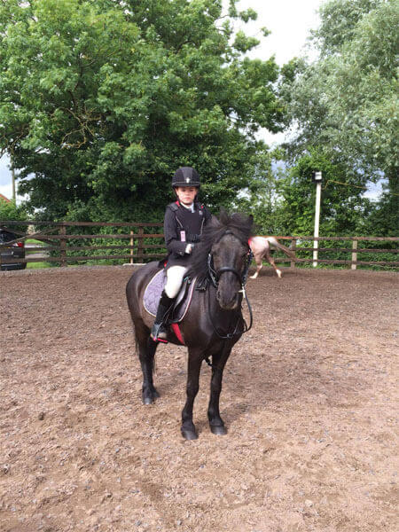 Standing to attention for the horse riding lesson